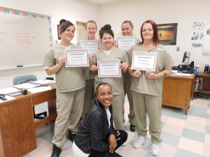 Group of five woman holding certificate of completion.