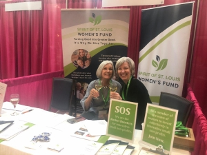 Two women sitting at SOS booth.